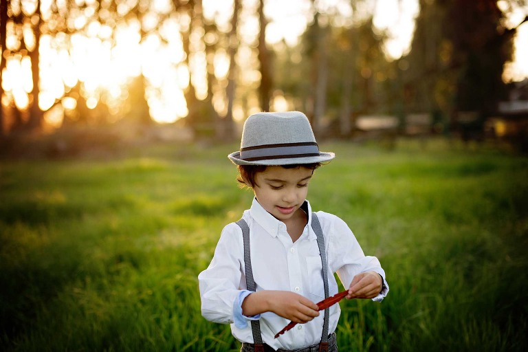 central-coast-child-photographer-captures-boy-meadow